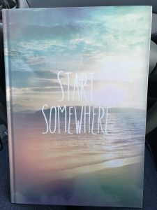 "Cover of journal titled ""Start Somewhere"""